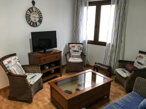 A television and/or entertainment center at Cosy flat in LAS CANTERAS