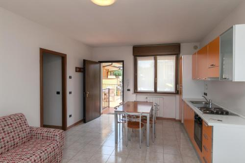 A kitchen or kitchenette at Meridiana Residence
