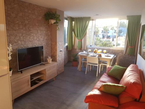 A seating area at Seaside apartment in Playa del Aguila
