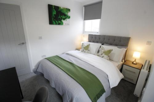 A bed or beds in a room at Willow Serviced Apartments - The Walk 2