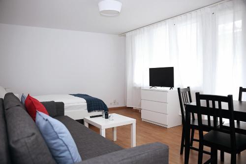 Star Vacation Homes Lucerne tesisinde bir televizyon ve/veya eğlence merkezi