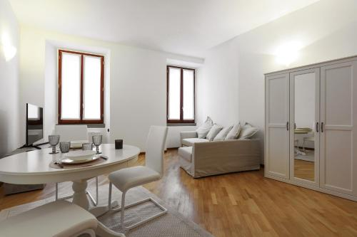 A seating area at Brera Design District Luxury Apartment