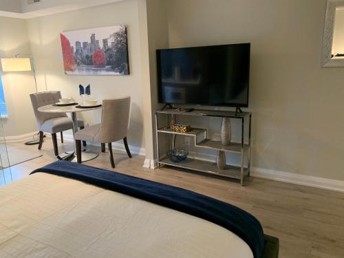 A television and/or entertainment center at Jet Furnished Suites Yorkville