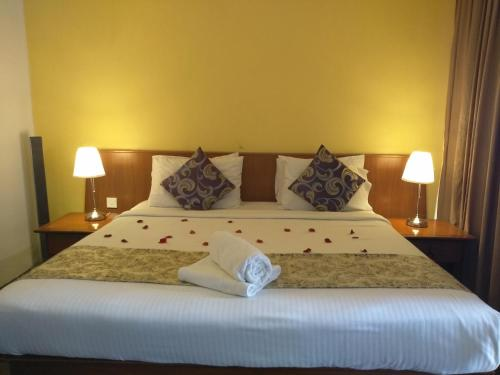 A bed or beds in a room at Langkawi Lagoon Resort by Langkawi Explore