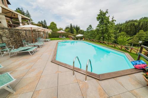 The swimming pool at or near Borgo Isora