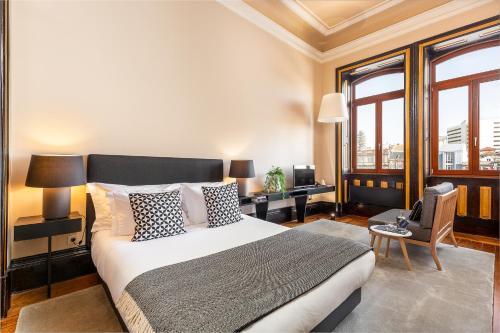 A bed or beds in a room at Your Opo Bolhao Apartments