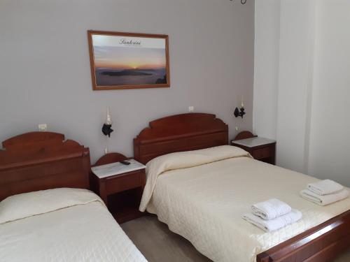 A bed or beds in a room at Emmanouela Studios & Villas