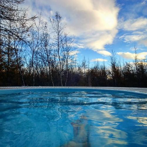 The swimming pool at or close to Hotel Kjarnalundur