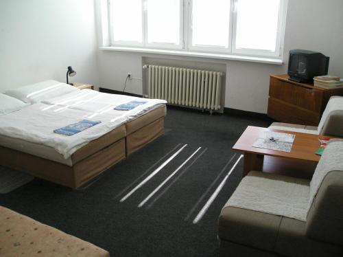 A bed or beds in a room at Apartmány Bratislava