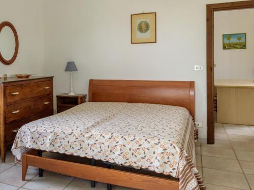 Letto o letti in una camera di Locazione turistica Biscotti's.2