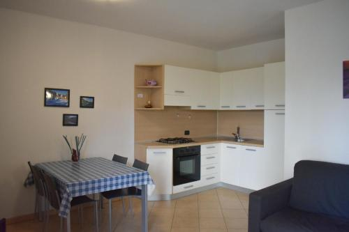 A kitchen or kitchenette at Appartamenti Righi
