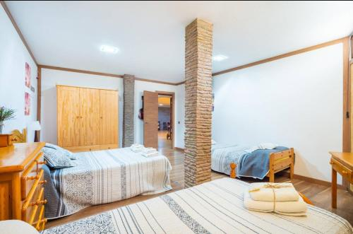 A bed or beds in a room at Casa Roque Aguairo
