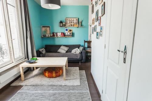 A seating area at HostnFly apartments - Superb apartment 2 steps from the Stade de France