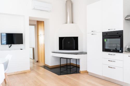 TV a/nebo společenská místnost v ubytování Atlantide holiday apartments