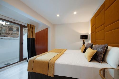 A bed or beds in a room at Habitat Suites Gran Vía