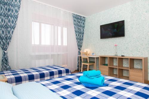 Кровать или кровати в номере Apartment on Titova 253/1 LUX