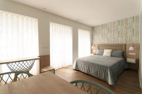 A bed or beds in a room at L&C Studio - Guimarães