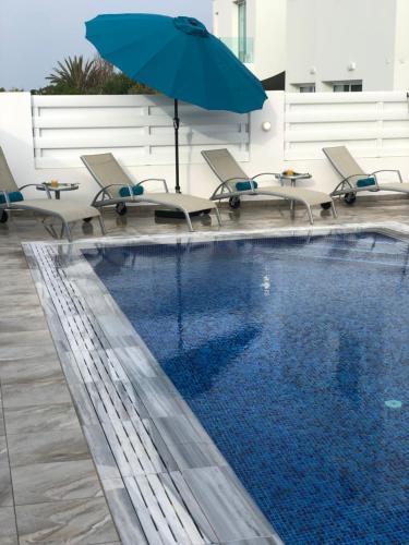 The swimming pool at or near Villa Ioli (Green Bay Villa 12)
