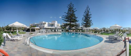 The swimming pool at or near Birikos Studios & Apartments
