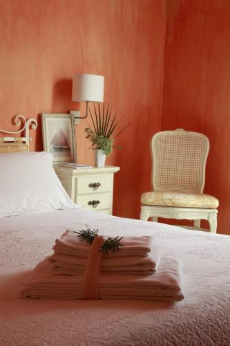 A bed or beds in a room at Albergo Ristorante Egadi