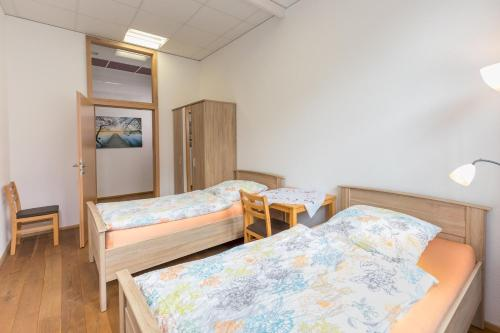 Ein Bett oder Betten in einem Zimmer der Unterkunft Ferienwohnungen Badischer Hof