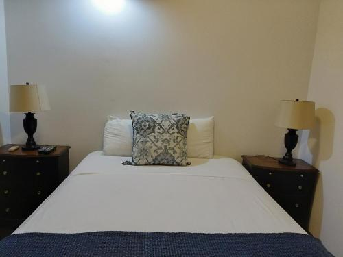 A bed or beds in a room at La Capitana Old San Juan