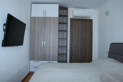 Кровать или кровати в номере Apart Hotel Orbi Towers