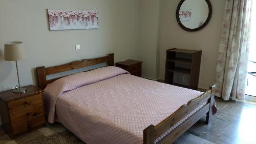 Ένα ή περισσότερα κρεβάτια σε δωμάτιο στο Marina Rooms