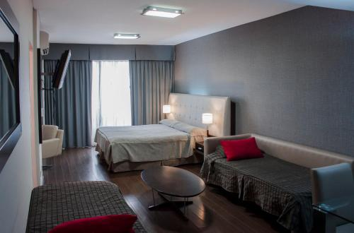 A bed or beds in a room at Recoleta Apartments