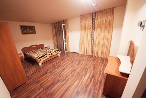 Ліжко або ліжка в номері Апартаменти в самому серці Івано Франківська.