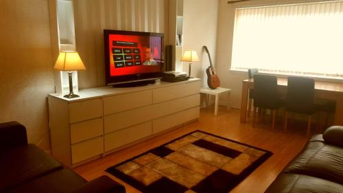 A television and/or entertainment center at Partick Apartment