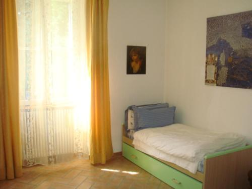 A bed or beds in a room at Villa Cardano