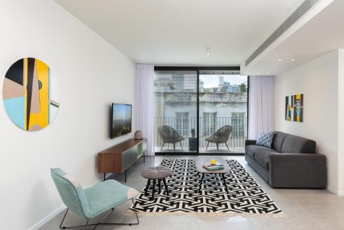 A seating area at Shenkin Apartments by Master