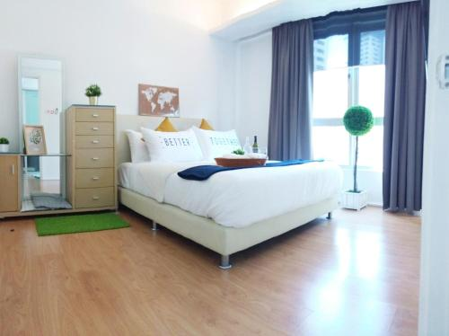 A bed or beds in a room at Mont Kiara Shopping Mall Izen-1 Kuala Lumpur