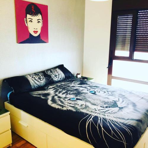 Кровать или кровати в номере Apartamento turístico