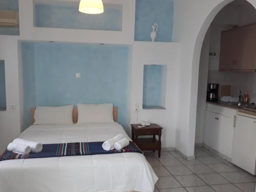A bed or beds in a room at Olympic Villas