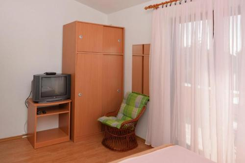 A television and/or entertainment center at Apartments Mladen Novalja - CIN04066-CYA