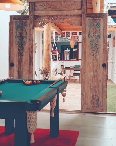 A pool table at Ventura Hostel