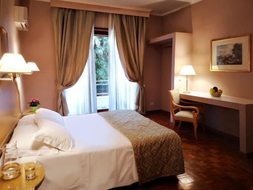 Кровать или кровати в номере Aurelia Residence San Pietro Aparthotel