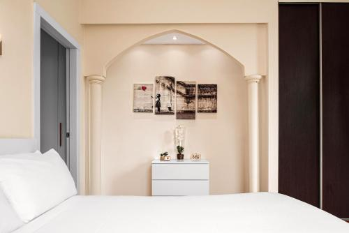 A bed or beds in a room at Elegant 2 bedrooms apartment in Brera