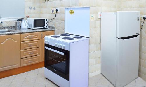 Kuchyň nebo kuchyňský kout v ubytování Al Muntaza building 101