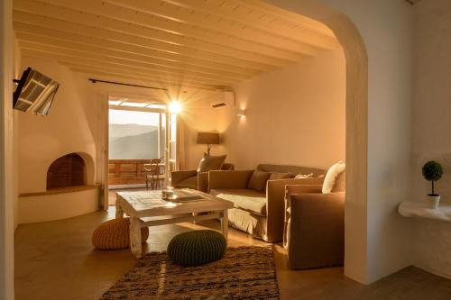 A seating area at Cova Mykonos Suites