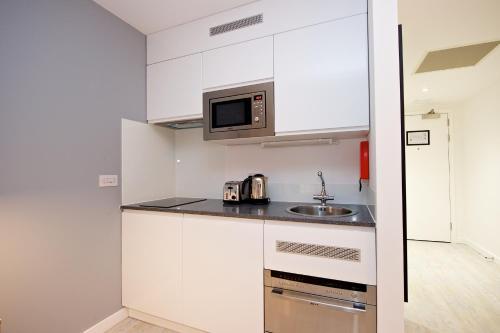 A kitchen or kitchenette at Staycity Aparthotels Centre Vieux Port