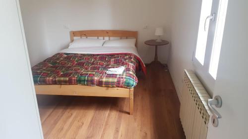 A bed or beds in a room at intero Bilocale da Antonio - free Wi-Fi