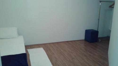 En eller flere senge i et værelse på Apto. Horto Florestal - J.B