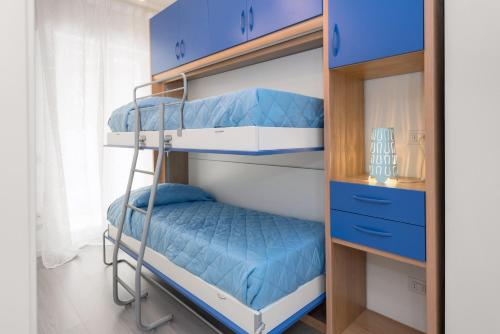 A bunk bed or bunk beds in a room at Dimore Verona