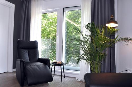 Prostor za sedenje u objektu Unique Center Apartment
