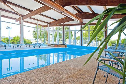 The swimming pool at or near Holiday resort Erzeberg Bad Emstal - DMG011005-FYA