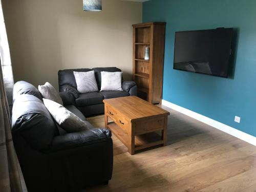 A seating area at Self Catering Accommodation, Isle of Benbecula