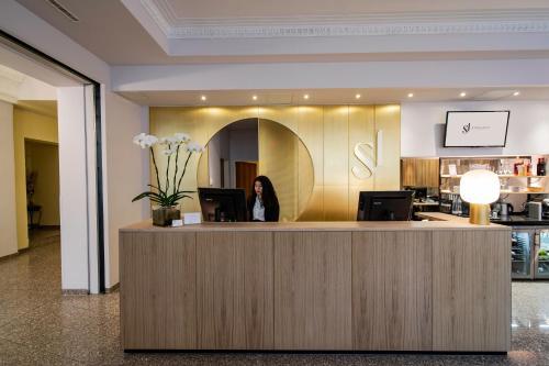 Staff members at Starlight Suiten Hotel Renngasse